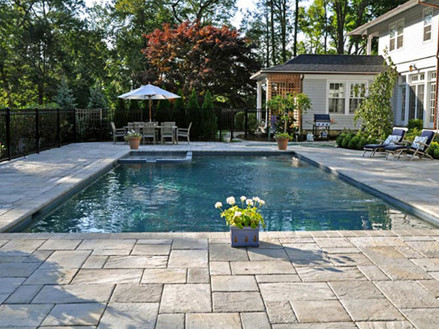 American pool service pool options Flagstone pavers around pool